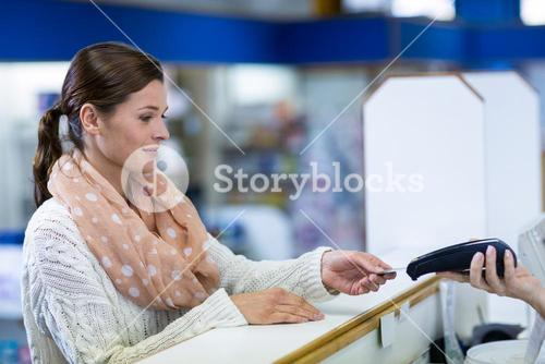 Customer making payment through payment terminal