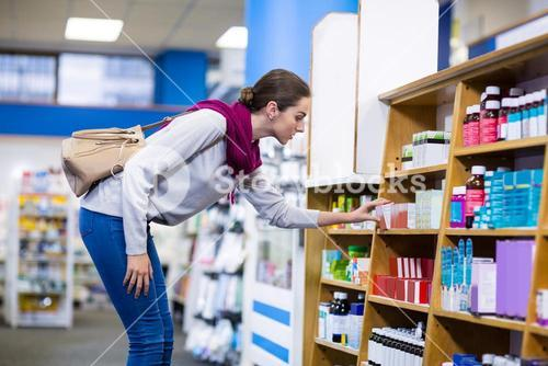 Customers checking medicines from shelf