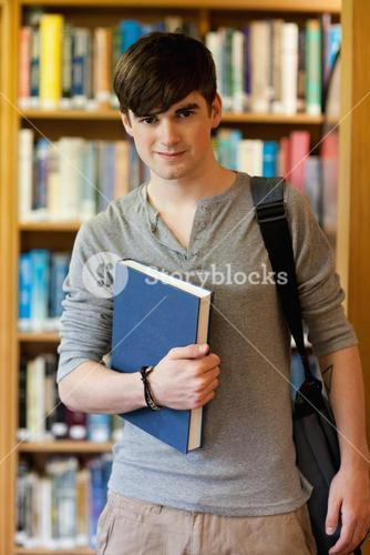 Young student holding a book