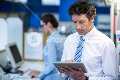 Pharmacist using digital tablet