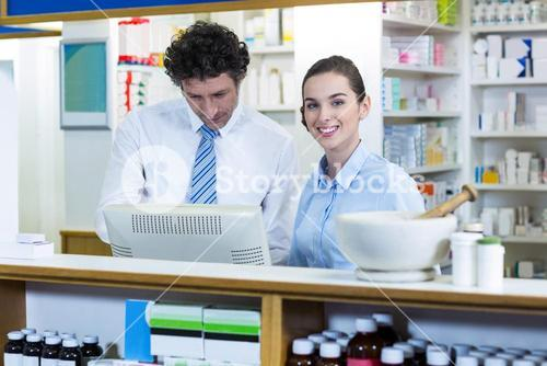 Pharmacists working at counter