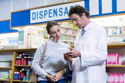 Pharmacist assisting the medicine to customer