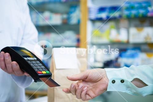 Customer taking credit card from payment terminal