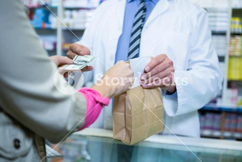 Pharmacist receiving payment from customer