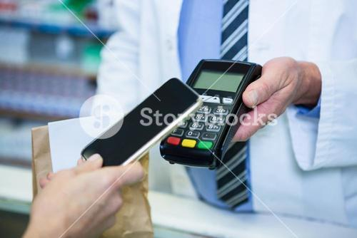 Customer making payment through smartphone in payment terminal