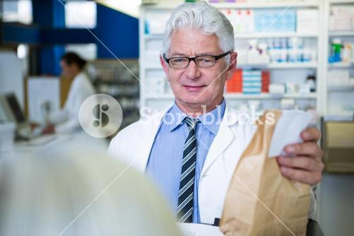 Pharmacist holding a medicine package