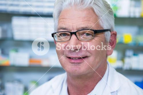 Smiling pharmacist in spectacles