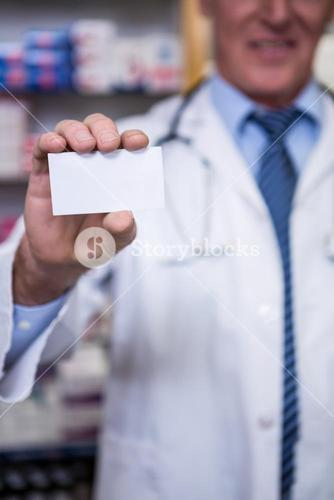 Pharmacist holding a prescription