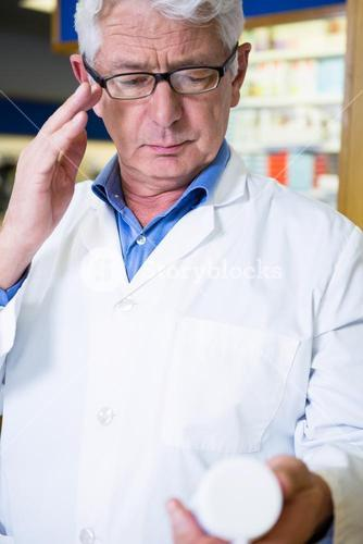 Pharmacist checking medicine in pharmacy