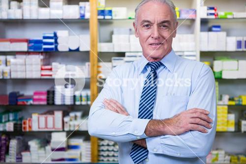Pharmacist standing with arms crossed