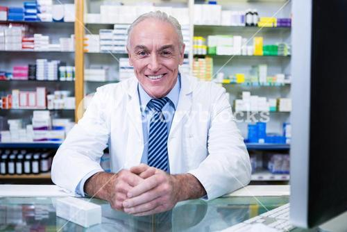 Pharmacist sitting at counter