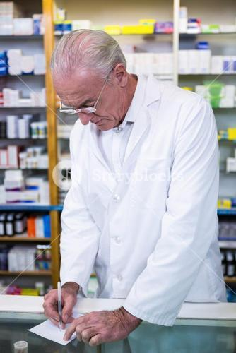 Pharmacist writing prescriptions for medicines