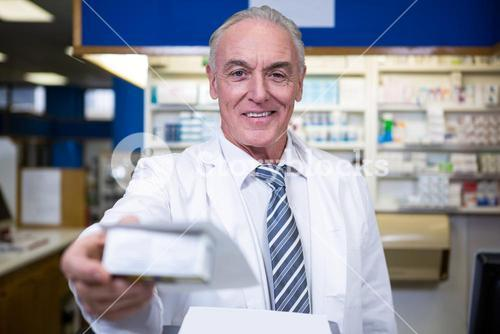 Pharmacist holding a medicine box
