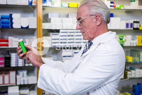 Pharmacist checking medicines