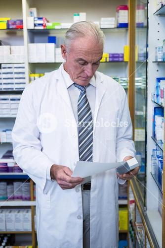 Pharmacist holding a prescription and medicine