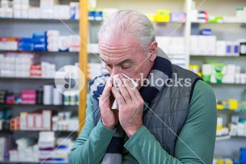 Customer covering his nose with handkerchief while sneezing