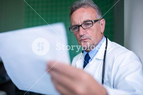 Doctor examining a report