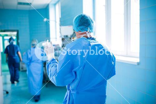 Rear view of surgeon walking in operation room