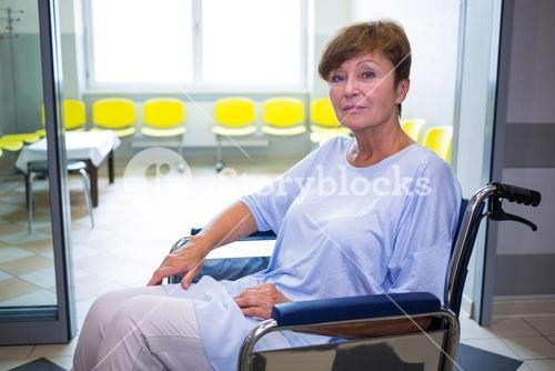 Portrait of sad senior patient sitting on a wheelchair
