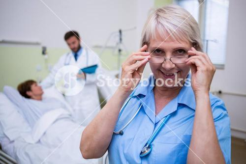 Portrait of smiling nurse wearing spectacle