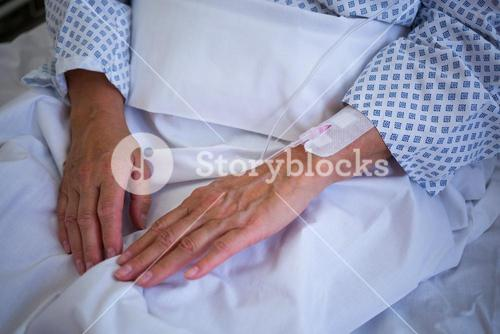 Close-up of patients hand with iv drip