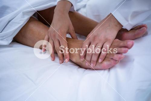 Doctor giving foot treatment to patient