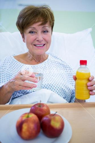 Portrait of smiling patient having a breakfast