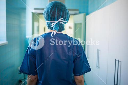 Surgeon standing in corridor at hospital