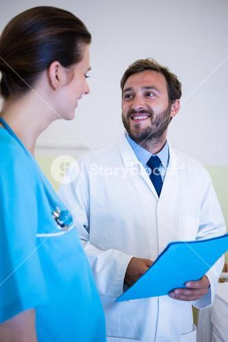Doctor interacting with nurse
