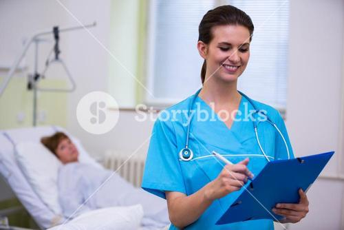 Nurse checking a medical report