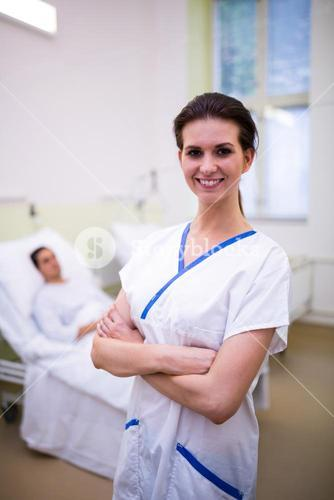 Female nurse standing in ward