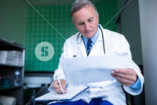 Doctor checking medical report