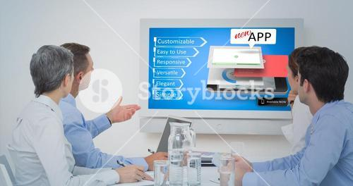 Composite image of attentive business team during a conference