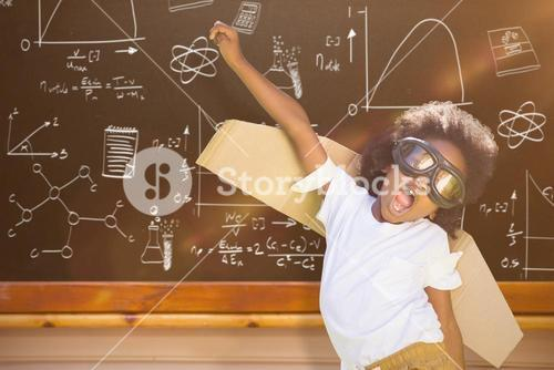Composite image of boy playing as an aviator at park