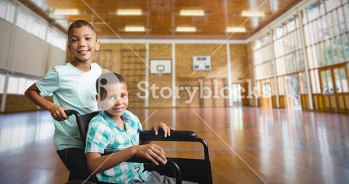Composite image of boy pushing friend wheelchair