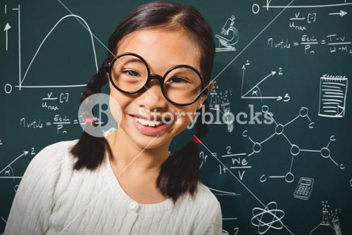 Composite image of girl smiling while standing