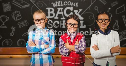 Composite image of three school kids with arms crossed