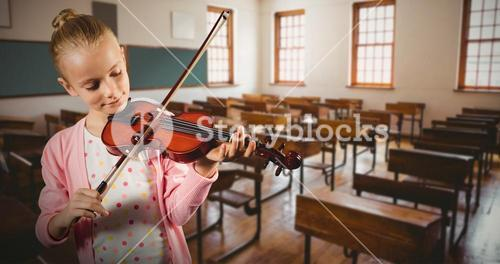 Composite image of little girl playing violin