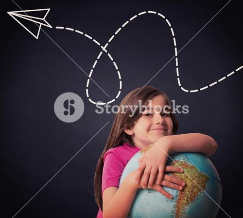 Composite image of cute pupil smiling holding globe