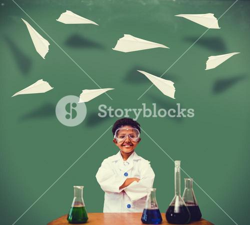 Composite image of cute pupil dressed up as scientist
