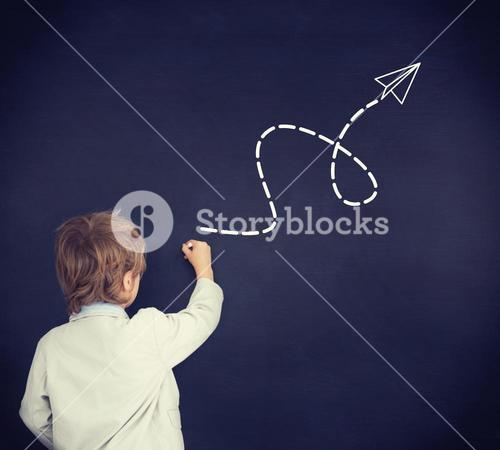 Composite image of cute pupil writing on board