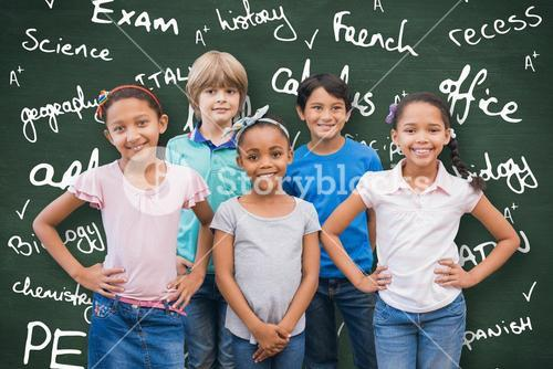 Composite image of cute pupils smiling at camera in classroom