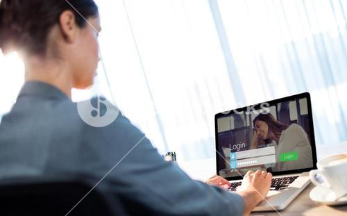 Composite image of login screen with dark-haired woman and laptop
