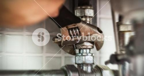 Close up of hand repairing pipes