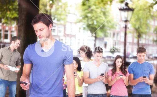 Composite image of man using his mobile phone