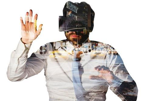 Composite image of businessman with virtual reality glasses at desk