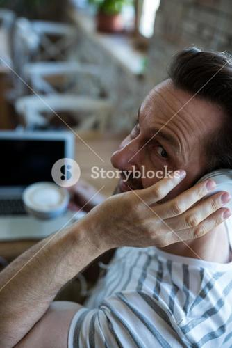 Man listening to headphones in the coffee shop