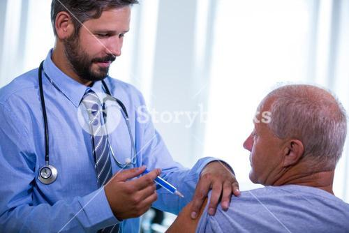 Male doctor giving an injection to a patient