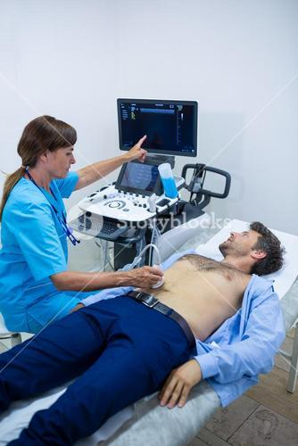 Man getting ultrasound of a abdomen from doctor