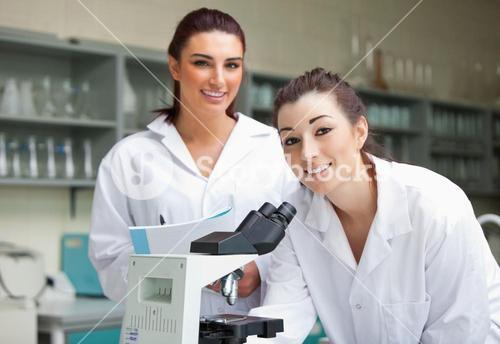 Science students posing with a microspcope